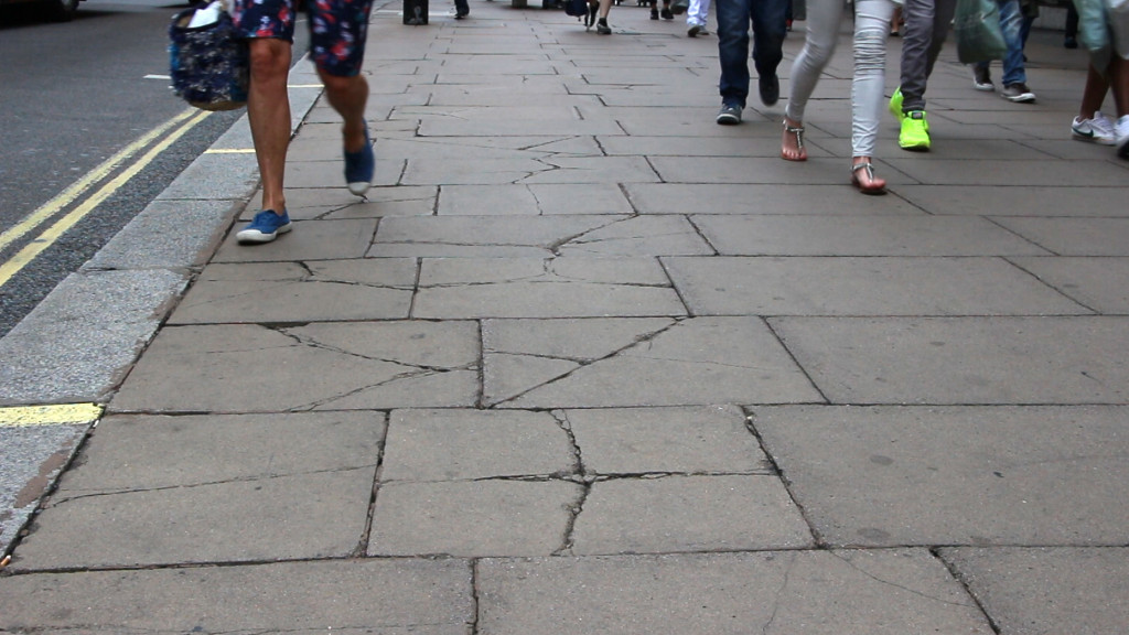 Much of Oxford Street, which has the highest retail turnover in the UK, is paved with trashy paving  materials (photo 2015)